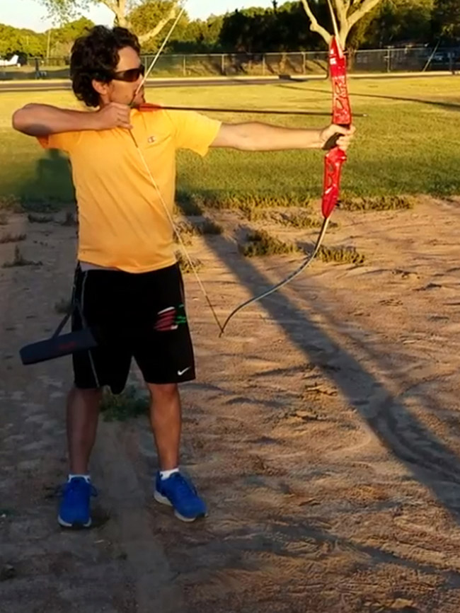 Picture of Robbie Vasquez practicing archery
